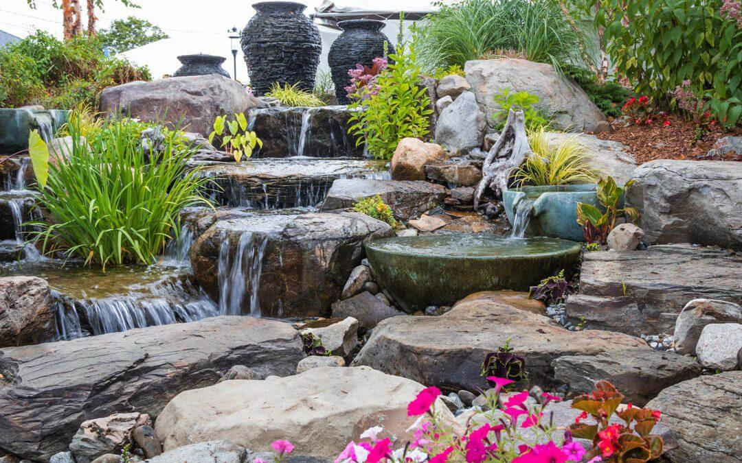 Landscape architecture with waterfall features for summer garden